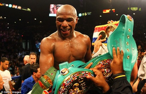 Mayweather Celebrates With The Belts
